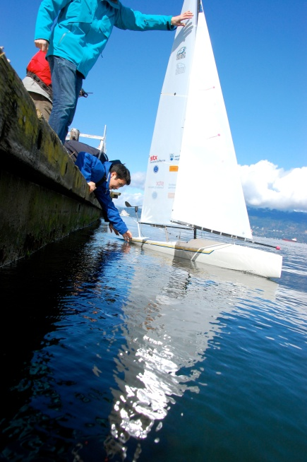 Greg and Adrian launching the Thunderbird 2012 robotic sailboat in the summer of 2012. UBC SailBot's Thunderbird 2012 has main & jib sails.